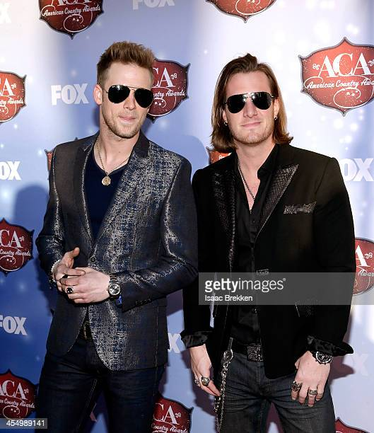 Recording artists Tyler Hubbard and Brian Kelley of Florida Georgia Line arrive at the American Country Awards 2013 at the Mandalay Bay Events Center...