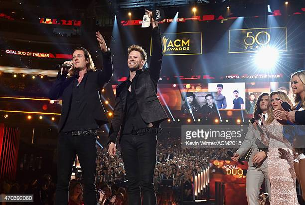 Recording artists Tyler Hubbard and Brian Kelley of Florida Georgia Line accept the award for Vocal Duo of the Year from The Band Perry members Reid...