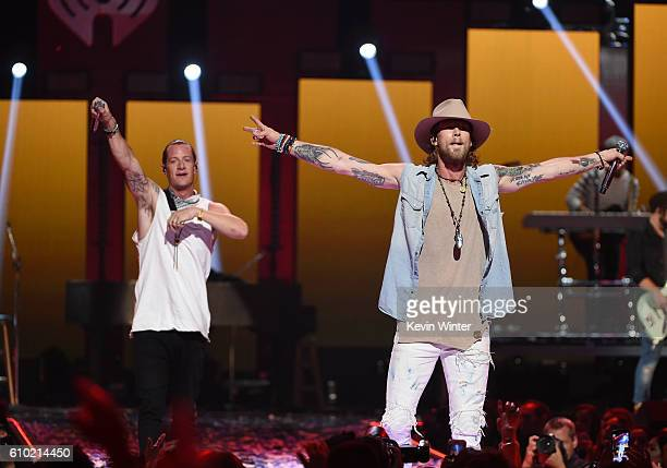 Recording artists Tyler Hubbard and Brian Kelley of music group Florida Georgia Line perform onstage at the 2016 iHeartRadio Music Festival at...