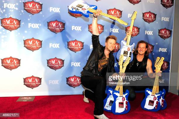 Recording artists Tyler Hubbard and Brian Kelly of Florida Georgia Line pose in th press room during the American Country Awards 2013 at the Mandalay...