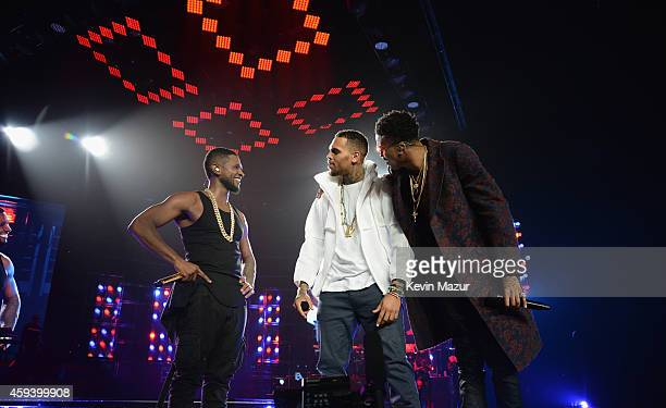 Recording artists Usher Chris Brown and August Alsina perform onstage during The UR Experience tour at Staples Center on November 21 2014 in Los...