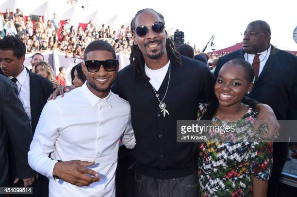 Recording artists Usher Snoop Dogg and Cori Broadus attend the 2014 MTV Video Music Awards at The Forum on August 24 2014 in Inglewood California