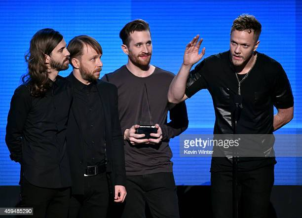 Recording artists Wayne Sermon Ben McKee Daniel Platzman and Dan Reynolds of Imagine Dragons accept the Favorite Alternate Artist award onstage at...
