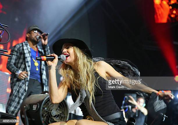 Recording artists will.i.am and Fergie of The Black Eyed Peas perform onstage with David Guetta during day 3 of the 2015 Coachella Valley Music &...