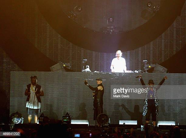 Recording artists william Taboo of The Black Eyed Peas DJ David Guetta and apldeap of The Black Eyed Peas perform onstage during day 3 of the 2015...