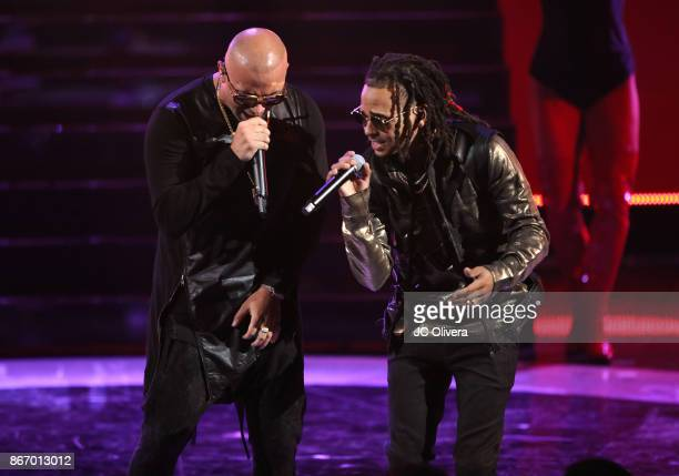 Recording artists Wisin and Ozuna perform onstage during the 2017 Latin American Music Awards at Dolby Theatre on October 26 2017 in Hollywood...