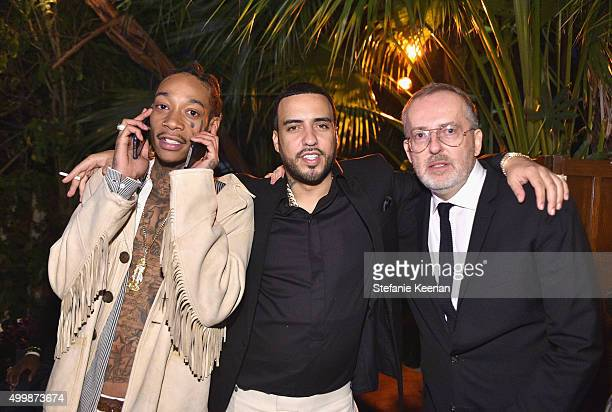 Recording artists Wiz Khalifa and French Montana and GQ creative director Jim Moore attend the GQ 20th Anniversary Men of the Year Party at Chateau...