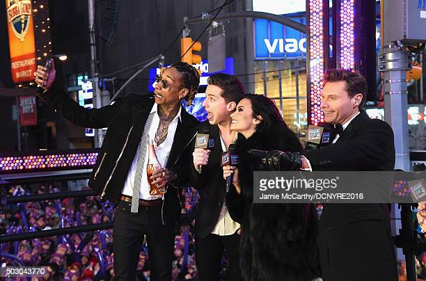 Recording artists Wiz Khalifa Charlie Puth Demi Lovato and Host Ryan Seacrest pose at the Dick Clark's New Year's Rockin' Eve with Ryan Seacrest 2016...