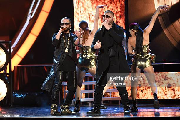Recording artists Yandel and Farruko perform onstage during the 15th Annual Latin GRAMMY Awards at the MGM Grand Garden Arena on November 20 2014 in...