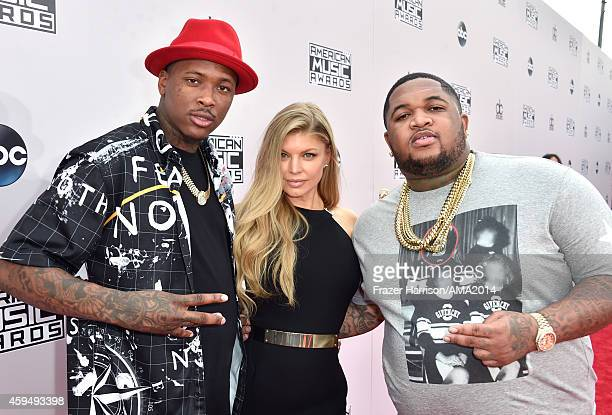 Recording artists YG Fergie and DJ Mustard attend the 2014 American Music Awards at Nokia Theatre LA Live on November 23 2014 in Los Angeles...