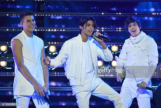 Recording artists Zabdiel De Jesus Erick Brian Colon and Christopher Velez of CNCO perform onstage during the 2016 Latin American Music Awards at...