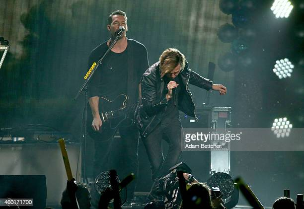 Recording artists Zach Filkins and Ryan Tedder of music group OneRepublic perform onstage at 1013 KDWB's Jingle Ball 2014 presented by Sky Zone...