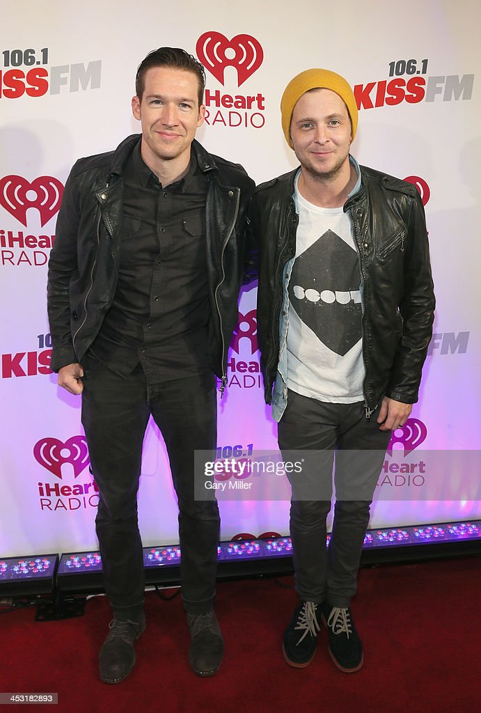 Recording artists Zach Filkins (L) and Ryan Tedder of OneRepublic pose backstage at 106.1 KISS FM's Jingle Ball 2013 American Airlines Center on December 2, 2013 in Dallas, Texas.