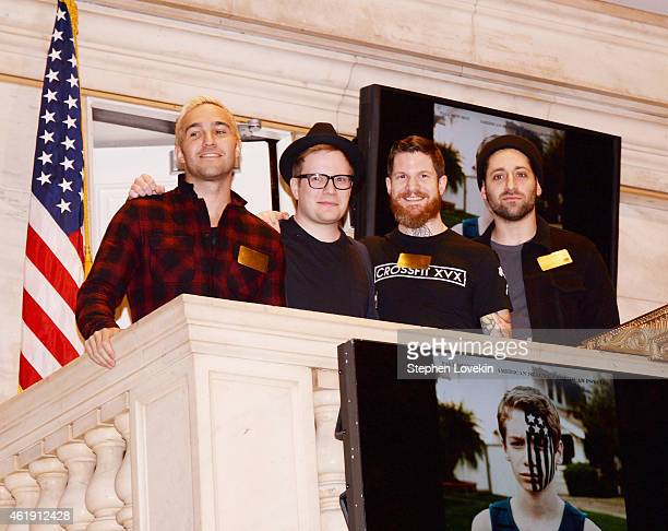 Recording artists/musicians Pete Wentz Patrick Stump Andy Hurley and Joe Trohman of Fall Out Boy pose for a photo after ringing the NYSE closing bell...