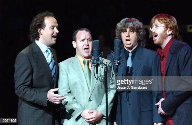 Recording Atrists Phish sing the national anthem prior to game four of the 2003 NBA Finals between the New Jersey Nets and the San Antonio Spurs at...