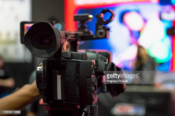 recording broadcas press and media photographer on duty in public news coverage event for reporter and mass communication - ルポルタージュ ストックフォトと画像