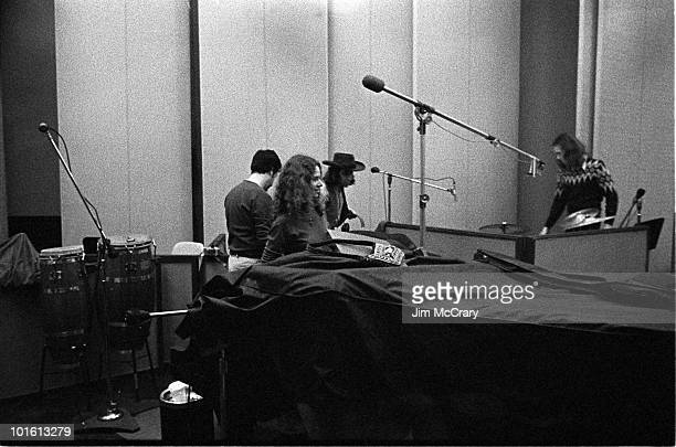 Recording engineer Hank Cicalo Carole King Danny Korchmar and Russ Kunkel during the recording of King's album 'Tapestry' at AM Records Recording...