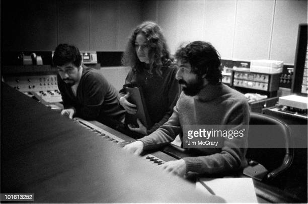 Recording engineer Hank Cicalo singersongwriter Carole King and record producer Lou Adler gather around the mixing desk for a playback in the control...