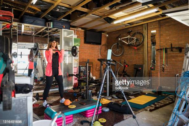 recording her home workout - menopossibilities stock pictures, royalty-free photos & images