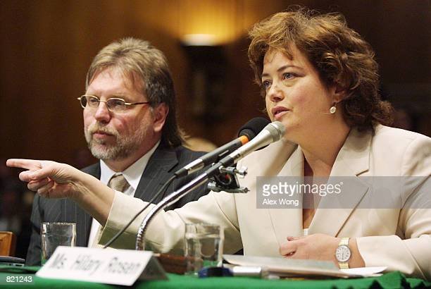 Recording Industry Association of America President and CEO Hilary Rosen right testifies as Gerry Kearby of Liquid Audio listens during a hearing on...