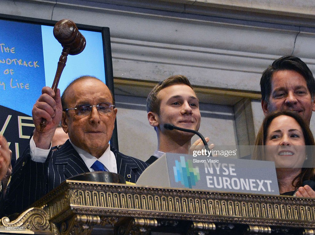 Recording industry mogul and author Clive Davis (L) rings the closing bell at the New York Stock Exchange on February 19, 2013 in New York City.
