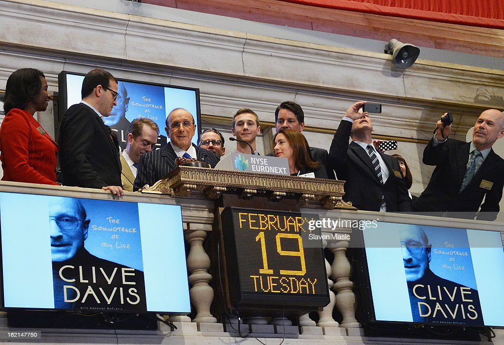 Recording industry mogul and author Clive Davis (4th L) rings the closing bell at the New York Stock Exchange on February 19, 2013 in New York City.