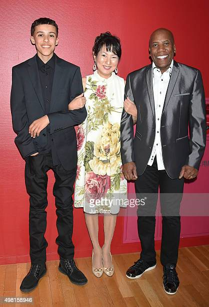 Recording musician Noah East pianist Hiroko Kokubu and Nathan East pose for a photograph during Kawasaki Jazz on November 21 2015 in Kawasaki Japan
