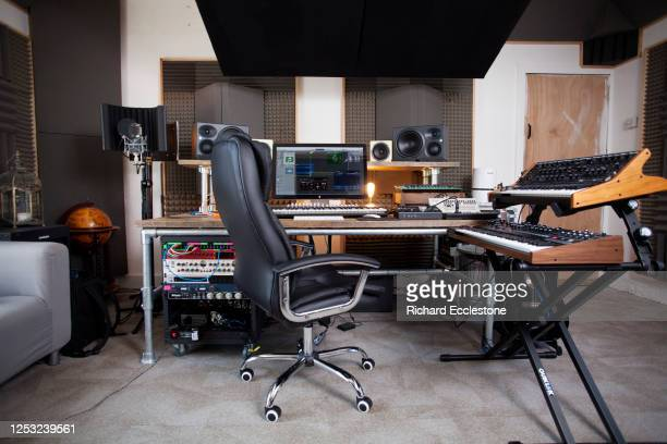 Recording studio control room and synthesizers being used by Mark Wilkinson , English record producer, DJ and remixer, United Kingdom, 2018.