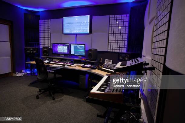 Recording studio control room and synthesizers being used by OC and Verde, electronic music duo and DJs, United Kingdom, 2018.