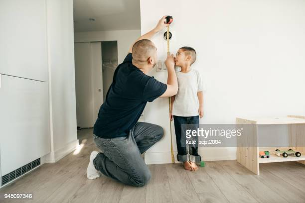 recording the height of a boy - high up stock pictures, royalty-free photos & images