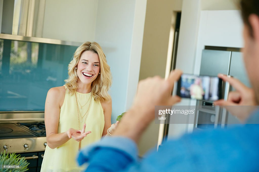 Recording their own home cooking videos : Stock Photo