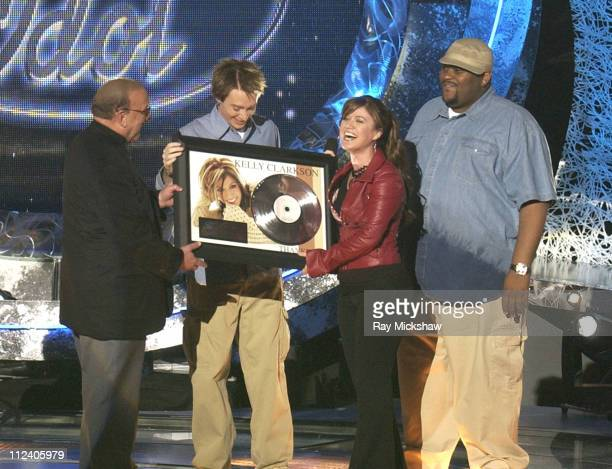 J Records CEO Clive Davis with Clay Aiken and Ruben Studdard winners of 'American Idol' Season 2 and Kelly Clarkson winner of 'American Idol' Season 1