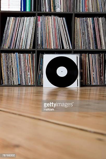 Records leaning against shelves