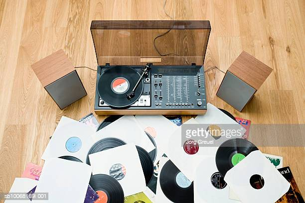 records lying on floor by 1970?s stereo system - deck stock pictures, royalty-free photos & images