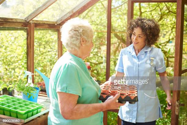 recouperating senior keeping active - house call stock photos and pictures