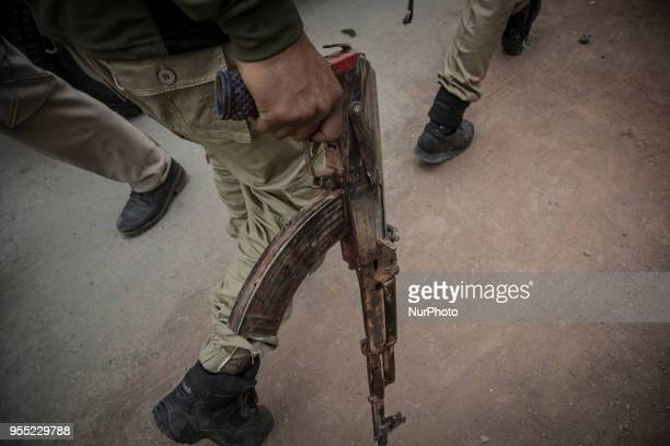 A recovered AK47 gun of the suspected rebel from the gunfight site is taken away by an Indan policeman Saturday May 5 in Srinagar Indiancontrolled...