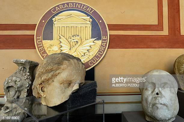 Recovered archaeological artifacts are pictured in Rome on March 22 2016 Italian and Swiss art police have busted open an international art smuggling...