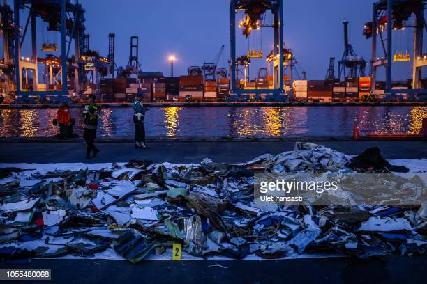 Recovered debris and personal items from Lion Air flight JT 610 lay on thre ground at the Tanjung Priok port on October 30 2018 in Jakarta Indonesia...