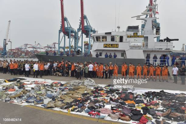 TOPSHOT Recovered debris from the illfated Lion Air flight JT 610 are laid out as Indonesia's President Joko Widodo visits the search and rescue...