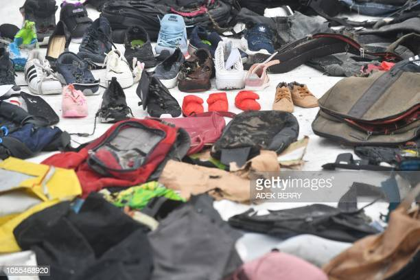 Recovered personal items of passengers on board the ill-fated Lion Air flight JT 610 are laid out at the search and rescue operations centre at a...