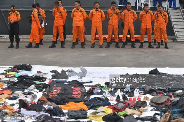 Recovered personal items of passengers on board the illfated Lion Air flight JT 610 are laid out as search and rescue personnel stand in formation...