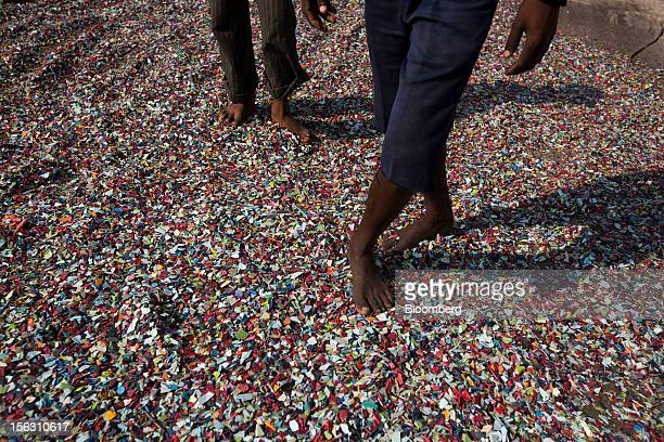 Recovered plastics are laid out to dry on a rooftop in the Dharavi slum area of Mumbai India on Friday Nov 9 2012 Indian industrial production...