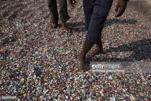 Recovered plastics are laid out to dry on a rooftop