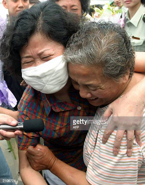 Recovered Severe Acute Respiratory Syndrome patient Hong Yu hugs a family member after being released from the Xiaotangshan SARS hospital in the...