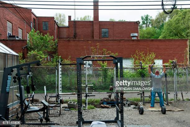 Recovering addict lifts weights at Recovery Point on April 19, 2017 in Huntington, West Virginia. Huntington, the city in the northwest corner of...