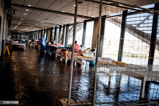 Recovering COVID19 coronavirus patients are seen at a ward at the Nelson Mandela Bay Stadium government isolation and quarantine facility in Port...