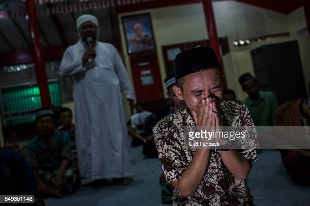 A recovering drug addict weeps during a prayer session led by Ustad Ahmad Ischsan Maulana the head of Nurul Ichsan Al Islami traditional...