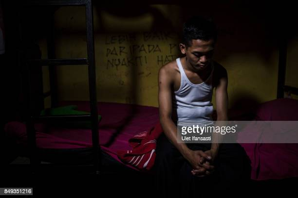A recovering drug addict Yordan poses for a photograph in his room at Nurul Ichsan Al Islami traditional rehabilitation centre on September 16 2017...