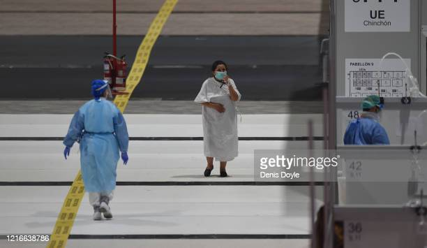 A recovering patient walks at the Temporary Hospital of the Community of Madrid authorized at IFEMA to treat patients with coronavirus on April 03...