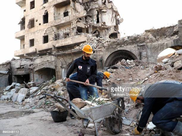 Recovering work continues on December 12 2017 in Aleppo Syria Bashar alAssad administration backed by Russia recaptured the area in December 2016